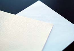 The feeling of turning pages can be more memorable with textured paper.